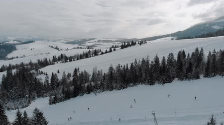 snowbord : Winter landscape in the mountains, ski resort top view 4k, drone.