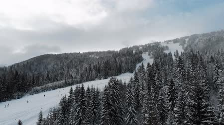 Winter landscape in the mountains, ski resort top view 4k, drone.