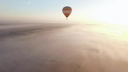 léggömb : Balloon Ride. A hot air balloon skims the ground above a valley on a calm fall morning, drifting with the wind.