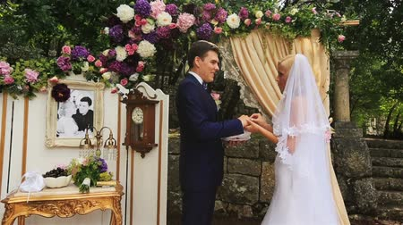 evli : Happy bride and groom exchaning rings in the wedding tent in Montenegro, Budva