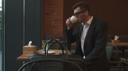 caffe : Close-up handsome male model businessman drinking a cup of espresso coffee. Hot beverage. Lunch time.