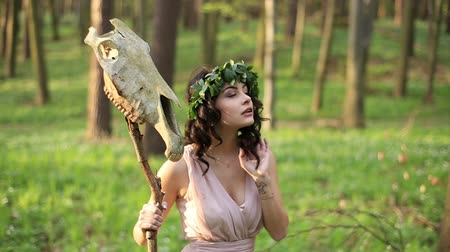 wampir : Beautiful young forest nymph with skull and in green wreath in the woods Wideo