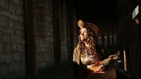 tikka : Beautiful blonde bride in ethnic dress at the medieval castle