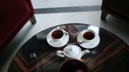 tatar : Close-up view of the composition of coffee set laying on the table in the restaurant. Wideo