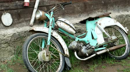 retro revival : The old motorcycle is covered with rust Stock Footage