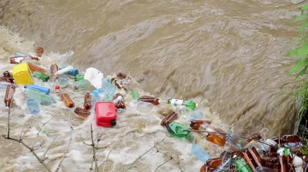 dumping : CARPATHIANS, UKRAINE - MAY 03, 2015: plastic bottles in the river water