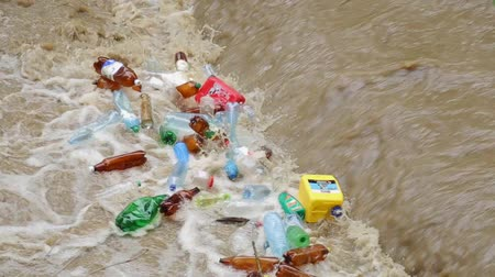 yem : CARPATHIANS, UKRAINE - MAY 03, 2015: plastic bottles in the river water