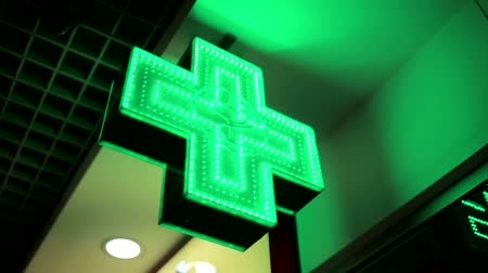 entrance : Green LED cross, pharmacy sign Stock Footage