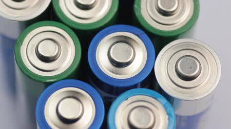 miktar : Macro Video of the Batteries Top. Concept of Energy, Power and Recycling. Stok Video