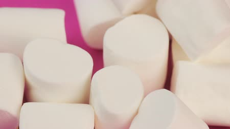 Heap of White, Soft, Fluffy Marshmallow on Pink Background. Unhealthy Food Concept.