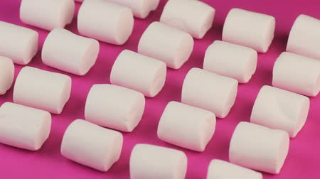 Fluffy Sweet Marshmallow on Pink Background. Food with Sugar Concept. Стоковые видеозаписи