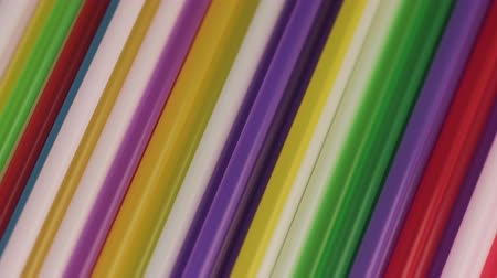 Macro Video of Many Colored Cocktail Tube.