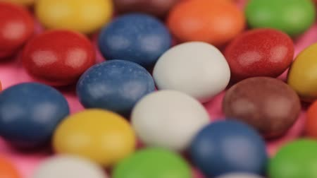 Colorful Chocolate Coated Drops Candy Lying on the Table.