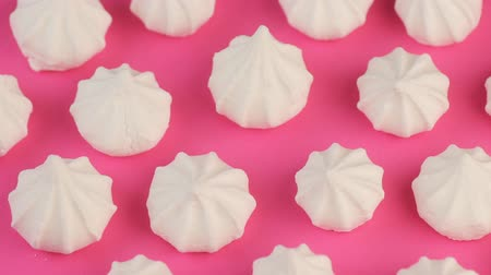 Macro Video of Soft, Fluffy, White Marshmallows on Pink Background.