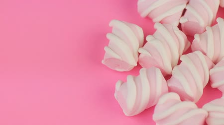 sakızlı : Many Different Colored Twisted Marshmallow on Pink Background with Copyspace.