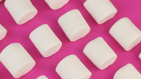 sakızlı : Heap of White, Soft, Fluffy Marshmallow on Pink Background. Unhealthy Food Concept.