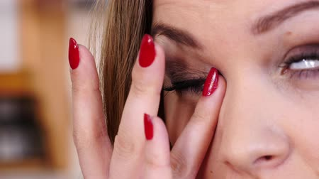 Close up of woman rubbing her eyes 影像素材