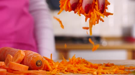 Grated carrot falling from top 影像素材