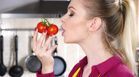 Woman eating small cherry tomatoes
