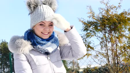 Young woman looking in distance during winter Dostupné videozáznamy