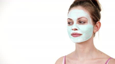 Girl with white green mud mask on face