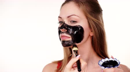 Girl applying black carbo mask to face Dostupné videozáznamy