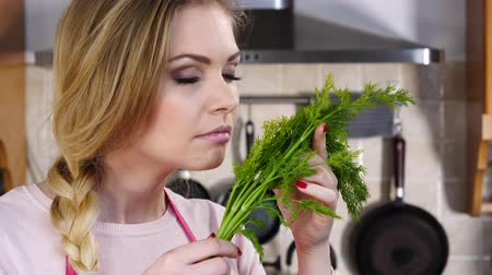 Young woman smelling dill herb 影像素材