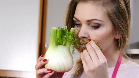 Woman holding raw fennel