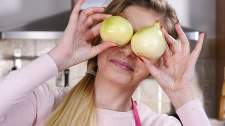 Funny woman playing with onion