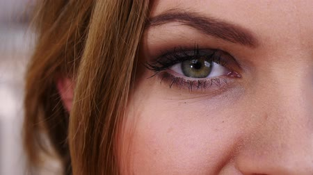 Close up of one woman eye blinking