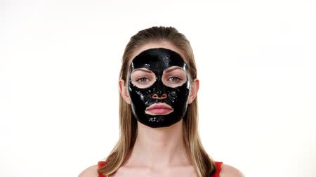 blackhead : Girl with black carbo peel off mask on face