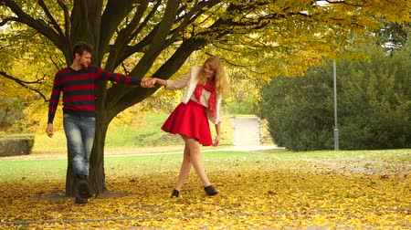 autumn leaves : Couple in love enjoying romantic date in park 4K Stock Footage