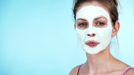 algler : Girl with dry white mud mask on face
