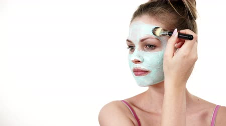 blackhead : Girl apply white green mud mask to face