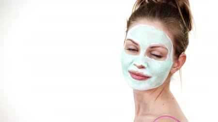 blackhead : Girl with white green mud mask on face