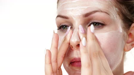 lotion : Woman applying mask cream on face