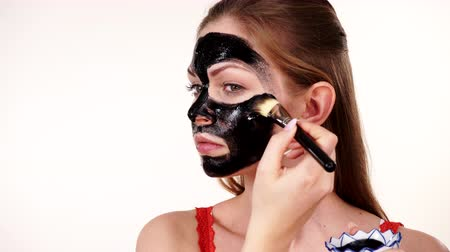blackhead : Girl applying black carbo mask to face Stock Footage