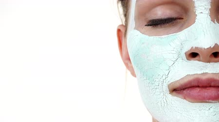 сухой : Girl with white green mud mask on face