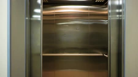 entrance : The elevator doors open. Opening the door is an elevator. Metal doors smoothly open. Stock Footage
