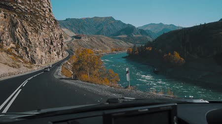 front cover : It is a mountain road, slow motion. Road trip at summer in Russia. View from the road and trees. Slow motion. Stock Footage