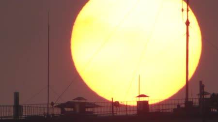 antena : Antennas silhouettes on background sun disk