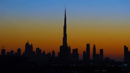 birleşik arap emirlikleri : High rise buildings in Dubai at sunset. Stok Video