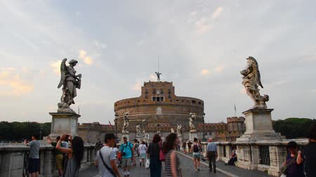 mermer : Tourist visit Castel Santangelo bridge and Berninis statue