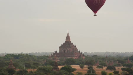 nyaung u : Hot air balloon over ancient temple at Bagan at dawn.