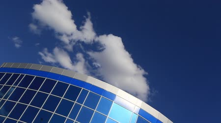 office life : Facade of office building on a blue sky and clouds background Stock Footage