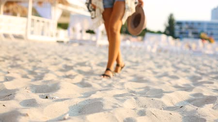 Beautiful young woman walking at the summer beach Stock Footage