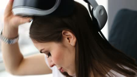 Young woman playing with VR helmet
