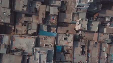 crematorium : India, Uttar Pradesh, Varanasi. A happy child greets you, the take-off of a drone over a block of slums in the city of the crematorium of Varanisi. The top view of the residential ghetto quarter.