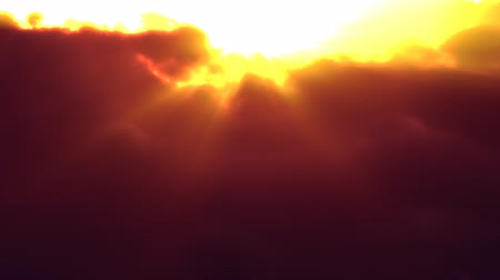 iluminado pelo sol : Sunset Clouds Flyby (Loop). Fly over volumetric clouds at sunset. Seamless loop.