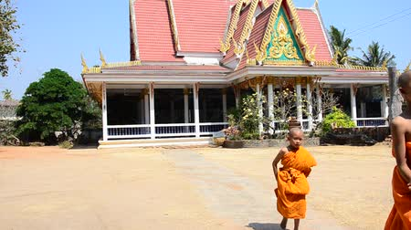 wat pho : Buddhist monks and Samanen or a novice monk in a Buddhist context walking at Wat Pho Sri Sa-at of Pon ngoy Village on February 8, 2015 in Surin Thailand.
